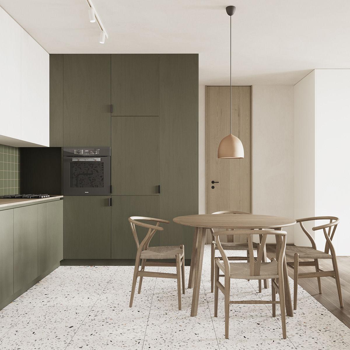Bếp sử dụng thêm tông xanh lục thẫm tạo điểm nhấn màu sắc cho căn hộ